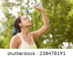 pretty brunette pouring water... | Shutterstock . vector #238478191