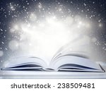 opened magic book with magic... | Shutterstock . vector #238509481