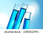 inclined test tubes with blue... | Shutterstock . vector #238562491