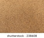 This is a close-up background shot of sand. - stock photo