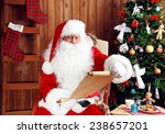 Santa Claus With List Of...