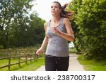 Woman Running In Countryside...