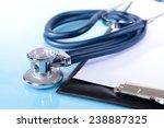 stethoscope on light blue... | Shutterstock . vector #238887325