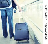 traveler with a suitcase on the ... | Shutterstock . vector #238916371