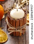Candle Decorated With Cinnamon...