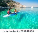 couple in kayak on the sea.... | Shutterstock . vector #239018959