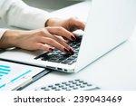 closeup of businesswoman typing ... | Shutterstock . vector #239043469
