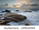 Small photo of Giles Baths at Coogee is known as a bogey hole - a semiformal rock pool open to the surging surf. Serene and idyllic at low tide but transforms into a raging whitewater in high turbulent seas.