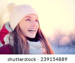 Beauty Winter Girl Blowing Sno...