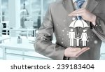 businessman protecting family... | Shutterstock . vector #239183404