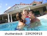 family playing in swimming pool ... | Shutterstock . vector #239290915