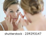 middle aged woman applying anti ... | Shutterstock . vector #239293147