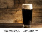 Black Beer On Wooden Background
