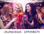 Stock photo friends drinking cocktails against gold and red lights 239348674