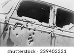The Bullet Riddled Car In Whic...