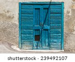 an image of an old door in italy