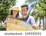 happy tourist couple with map | Shutterstock . vector #239555551