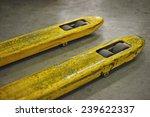 closeup of yellow pallet trucks - stock photo