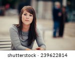 attractive young woman sitting... | Shutterstock . vector #239622814