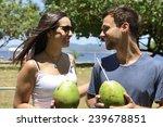 happy couple drinking coconut... | Shutterstock . vector #239678851