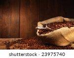 burlap sack of coffee beans... | Shutterstock . vector #23975740