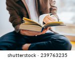 man reading a book | Shutterstock . vector #239763235
