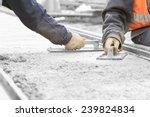 construction workers leveling... | Shutterstock . vector #239824834