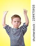 little boy with his hands... | Shutterstock . vector #239975935