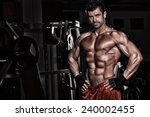 bodybuilder posing in the gym | Shutterstock . vector #240002455