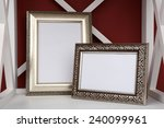 Two Photo Frames On Shelf  On...