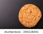 oat cookies on the old shabby... | Shutterstock . vector #240128341