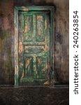 closed old wooden door on...