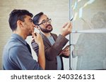 asian manager pointing at... | Shutterstock . vector #240326131