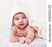 the infant lying on white towel | Shutterstock . vector #240332125