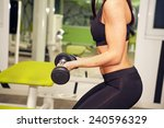 in the gym   girl is exercising ... | Shutterstock . vector #240596329