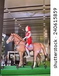 Small photo of AKIHABARA, TOKYO - DECEMBER 27, 2014: Arima Kinen horse race event celebrated in the electric town of Akihabara. Race is on December 28. Japanese character Ultraman rides on the thoroughbred horse.