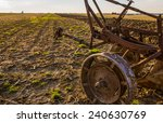 Close Up View Of Plow In Field.