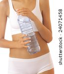 slim woman body and water bottle - stock photo