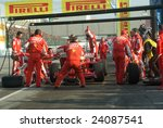 Small photo of BOLOGNA,ITALY-06 DECEMBER 2008: Ferrari racing team simulate a classic pit stop at the 2008th edition of Motor Show in Bologna,Italy