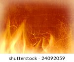 Close-up of fire and flames on a background of an old wall - stock photo