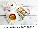 Colorful Macaroons With Cup Of...