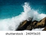 Big Waves Splashing Over Rocks