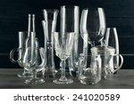 different glassware on dark... | Shutterstock . vector #241020589