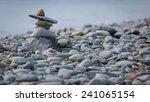 inukshuk on the coast in... | Shutterstock . vector #241065154