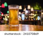 glass of beer with bar scene in ...   Shutterstock . vector #241070869