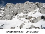 Rocks Covered By White Snow In...