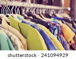 some used clothes hanging on a... | Shutterstock . vector #241094929