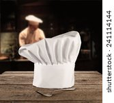 single fork and cook hat  | Shutterstock . vector #241114144