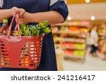 woman holding shopping basket... | Shutterstock . vector #241216417