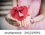 woman hands holding a gift | Shutterstock . vector #241219591